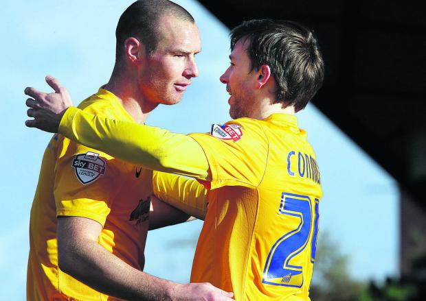 David Connolly (right) is congratulated by fellow United striker James Constable after scoring in last Saturday's 3-0 win against Mansfield Town