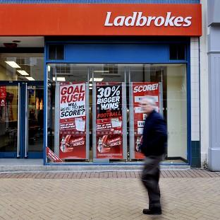 Bookmaker Ladbrokes warned it could close 40-50 shops as profits slumped 66%