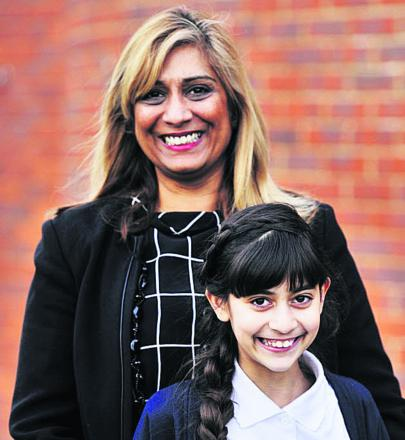 DELIGHTED: Pam Cameron and her daughter Chauni, 11, who got into first choice secondary, Heyford Free School, after