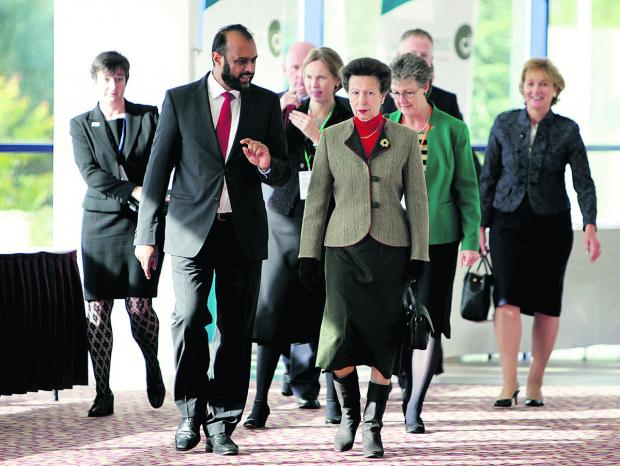 Banbury Cake: Victim Support chief executive Javed Khan leads the Princess Royal into the conference at Oxford's Kassam Stadium in 2012; below, volunteer Sheila Spencer