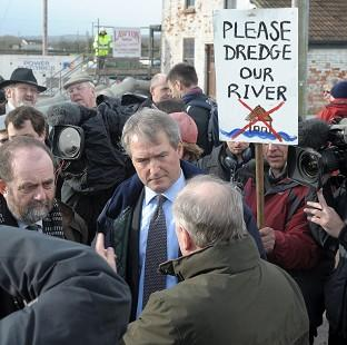 Banbury Cake: Environment Secretary Owen Paterson (centre) visiting Northmoor Pumping Station, Somerset, in January