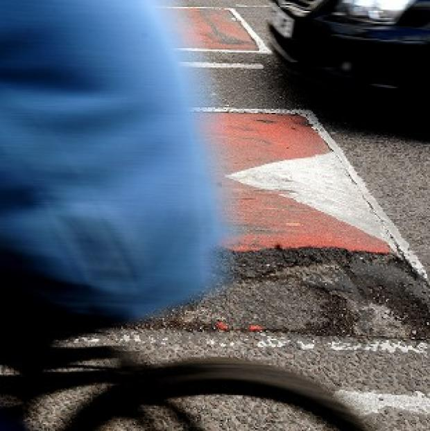 Banbury Cake: A cyclist died after hitting a pothole