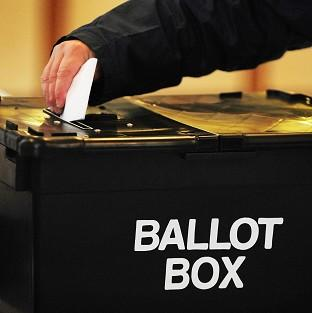 Postal voting should be restricted to cut down on fraud, an MP has said