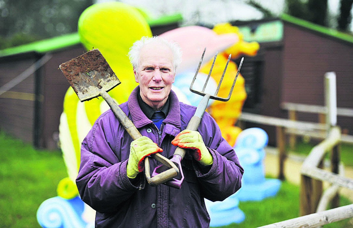 Volunteer George Hunt helped dig new flower beds at Fairytale Farm