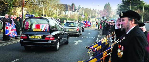 Mourners pay their respects to Sapper Adam Moralee at Headley Way as the cortege approaches the John Radcliffe Hospital.