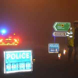 Banbury Cake: Police man a road block in Gillingham, near Beccles, Norfolk, as emergency services are attending a helicopter crash in Norfolk, police said.