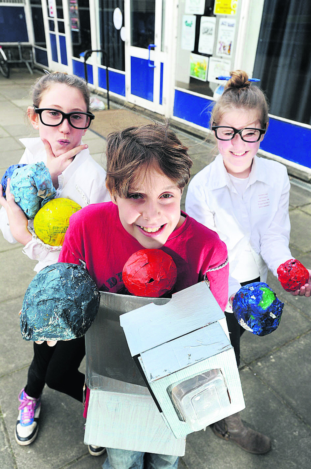 Cherwell School pupils, from left, Rose Statford, 12, Molly Taylor and Lucy Honey, both 11, with their models of the planets             Picture: OX66015 Jon Lewis