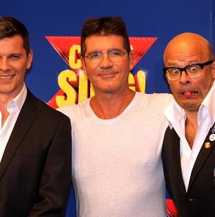Banbury Cake: Nigel Harman (left) will play Simon Cowell (centre) in the musical penned by Harry Hill (right).