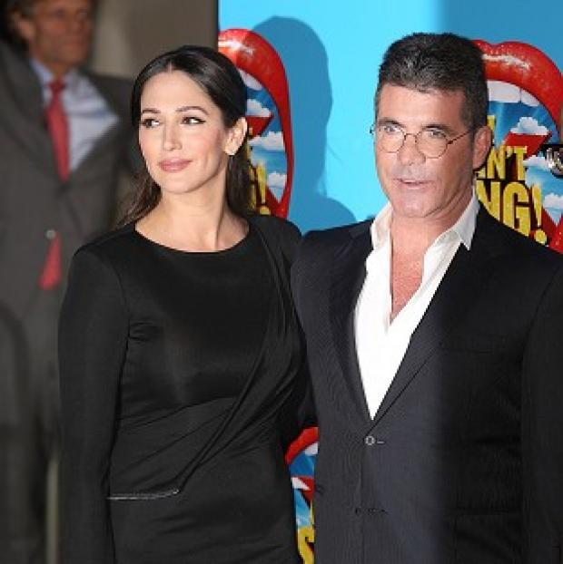Banbury Cake: Lauren Silverman and Simon Cowell attending the opening night of I Can't Sing! The X Factor Musical