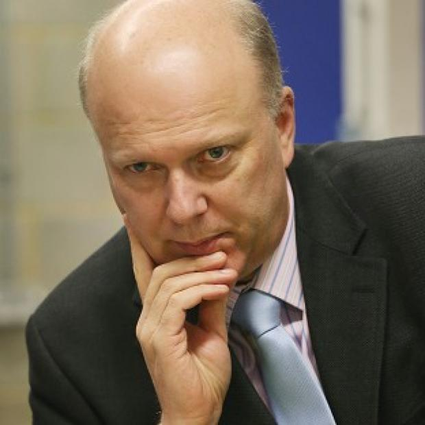 Banbury Cake: Justice Minister Chris Grayling has hit back at criticism of rules on prisoners' access to books