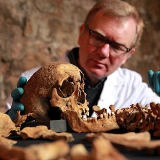 Osteologist Don Walker with some of the skeletons that were dis