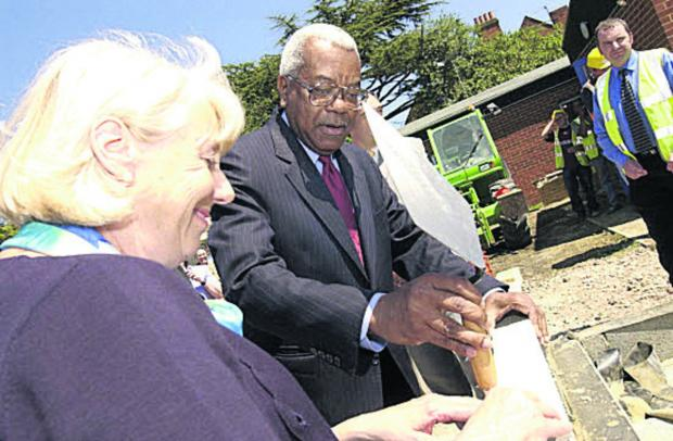 Banbury Cake: 2002: Sir Trevor McDonald and Valerie Bell lay the foundation stone of Douglas House