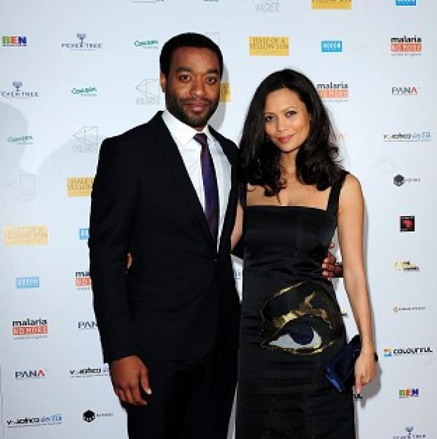 Banbury Cake: Chiwetel Ejiofer (left) and Thandie Newton attending the premiere of Half of A Yellow Sun at the Odeon Streatham, London.