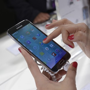 The new Samsung Galaxy S5 and three new smartwatches have become available (AP)