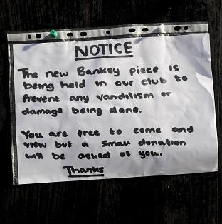 Banbury Cake: A notice sits where the latest officially confirmed Banksy artwork was, on Clements Street in Bristol