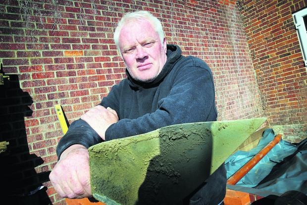 Banbury Cake: Bricklayer Simon Wells says he is so busy he is having to turn work away. Picture: OX66598 Damian Halliwell