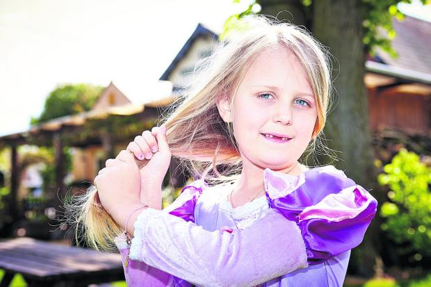 Freya Gregory has a drastic haircut to help poiorly children who need wigs