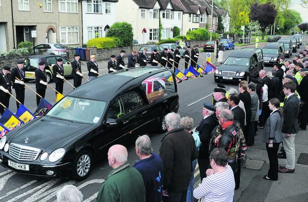 HONOUR: Members of the public and British Legion stalwarts stand in silence at Headley Way, Oxford, as the cortege arrives at the John Radcliffe Hospital
