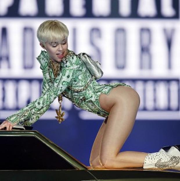 Banbury Cake: Miley Cyrus performs in concert at the O2 Arena, London, on the UK leg of her Bangerz tour.