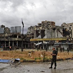 Banbury Cake: Syrian government forces inspect damage in Homs