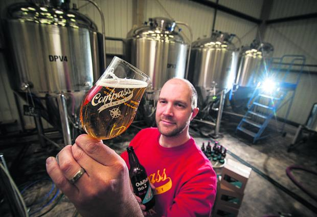 Thirsty work: head brewer Mattias Sjöberg holds up a glass of new pale ale