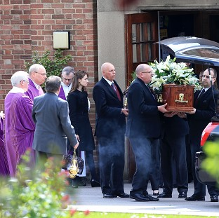 Teacher's passion hailed at funeral