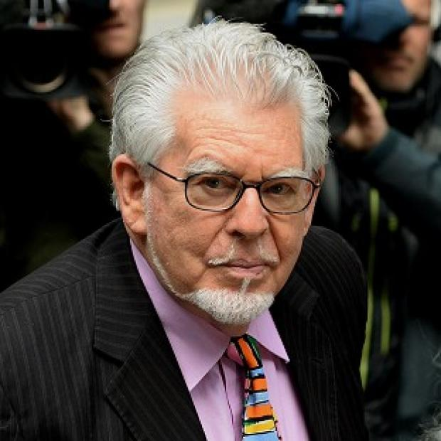 Banbury Cake: Rolf Harris denies the charges.