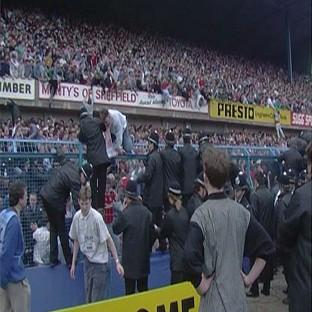 Banbury Cake: People climbing over the fence at the Leppings Lane end of Hillsborough Stadium as the tragedy unfolded