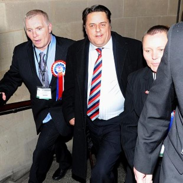 Banbury Cake: BNP leader Nick Griffin (centre) arrives at the European Parliamentary elections count at Manchester Town Hall