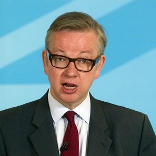 Education Secretary Michael Gove said he was wrongly accused of banning modern American novels from the GSCE syllabus.