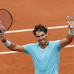 Rafael Nadal defeated 20-year-old Dominic Thiem to reach the third round of the French Open (AP)