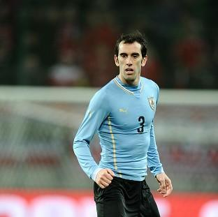 Uruguay's Diego Godin expects England to be top opponents at the World Cup