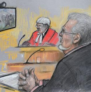 Banbury Cake: Court artist sketch of Rolf Harris being shown footage of a TV game show in which he appeared during the 1970s