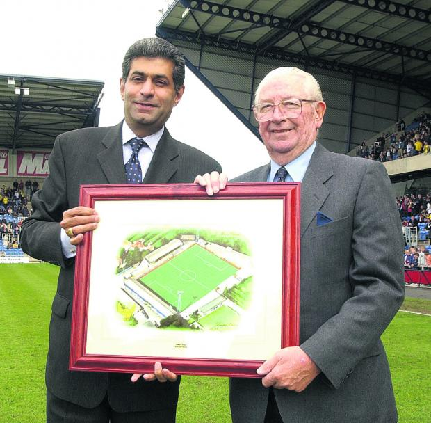 Jack Casley (right) receives a framed picture of United's former Manor Ground from t