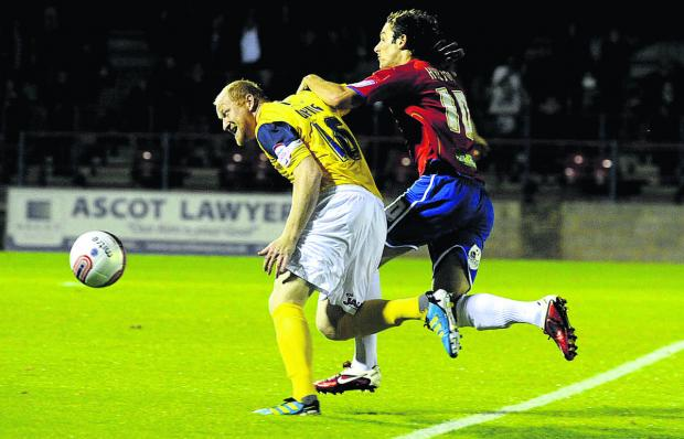 Danny Hylton, seen battling for the ball with Oxford United's Andy Whing while playing for Aldershot Town in a Johnstone's Paint Trophy tie three years ago, can't wait to link up with his new teammates