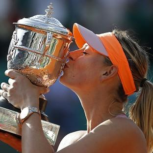 Maria Sharapova kisses the trophy after winning the French Open in a thrilling three-set final (AP)