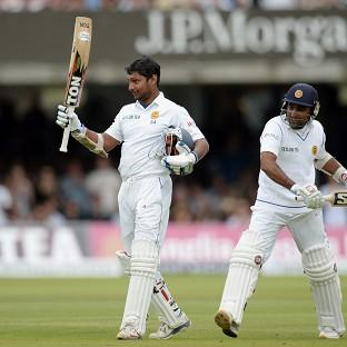 Kumar Sangakkara, left, celebrates his century
