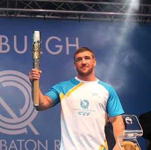 Banbury Cake: Alex Arthur carried the Glasgow 2014 Queen's Baton on to the stage as it ended the day in Edinburgh (David Cheskin for Glasgow 2014)