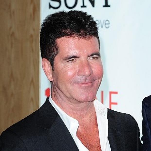Banbury Cake: Simon Cowell said he will support son Eric if he wants to be a singer, but will be honest about his abilities