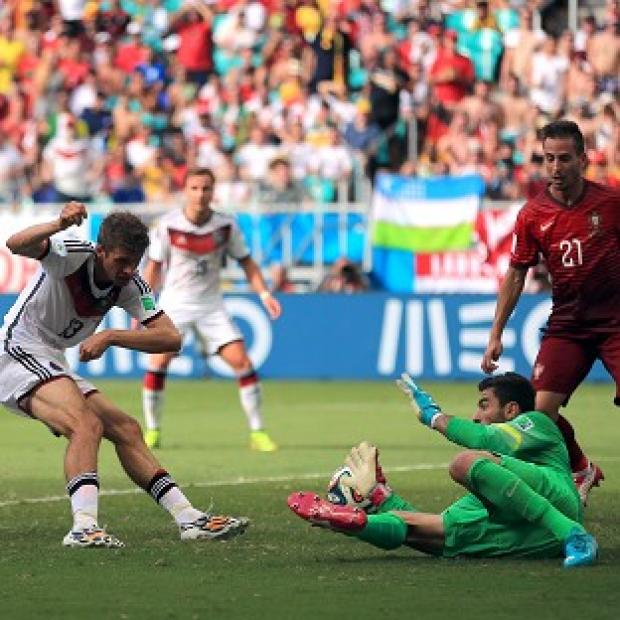 Banbury Cake: Thomas Muller, left, scored a hat-trick against Portugal