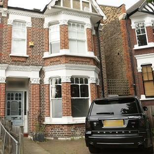 Banbury Cake: The front of former footballer Ian Wright's house in London, where his wife and children were burgled at knifepoint.