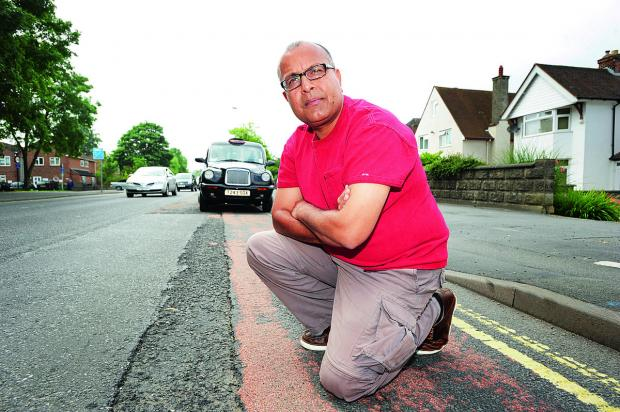 Banbury Cake: City councillor Saj Malik, a taxi driver, pictured on one of the 'gateways' into the city, London Road, where he says the potholes are a poor welcome for visitors. Picture: OX68073 Jon Lewis
