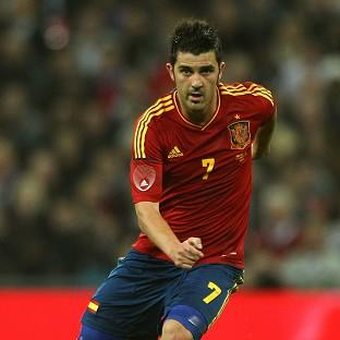 Spain striker David Villa signed off his international career with