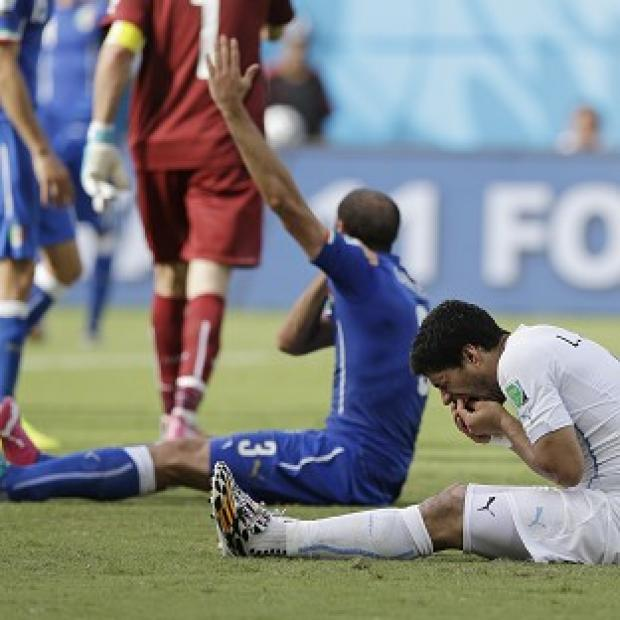 Banbury Cake: Uruguay's Luis Suarez, right, is under investigation by FIFA (AP)