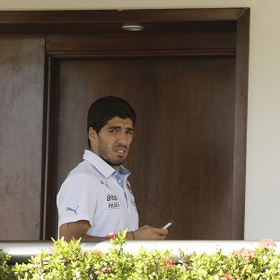 Luis Suarez did not appear at the hearing (AP)