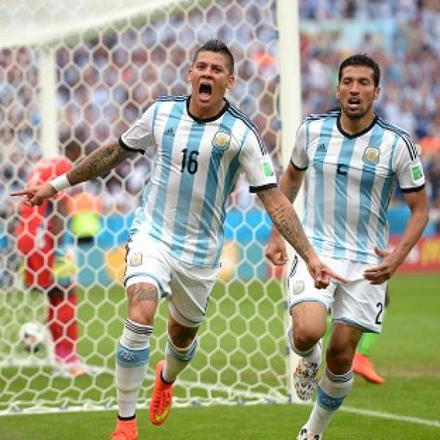 Banbury Cake: Marcos Rojo, left, scored in Argentina's win over Nigeria