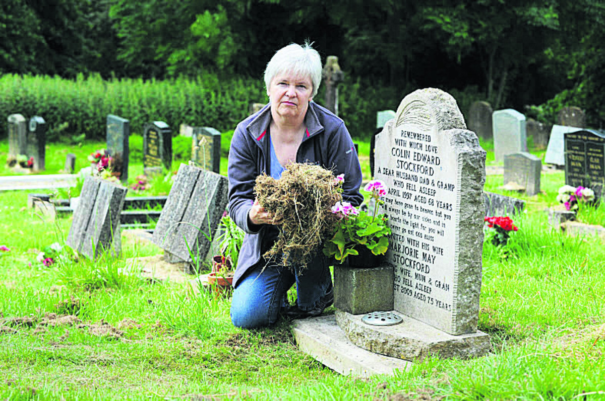 Colleen Green with the grass cuttings beside her parents' grave