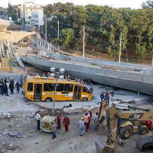 A probe is underway after an overpass collapsed in Belo Horizonte killing two (AP)