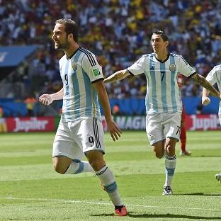 Argentina's Gonzalo Higuain, left, celebrates scoring the winner (AP)