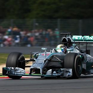 Lewis Hamilton won the British Grand Prix to close to within four points of his Mercedes team-mate Nico Rosberg in the drivers' championship